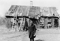 0107229 © Granger - Historical Picture ArchiveHENRY ROBINSON, c1937.   An former slave in front of his dilapidated home in rural America.