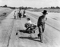 0121980 © Granger - Historical Picture ArchiveHOMELESS FAMILY, 1939.   Family with five children traveling through Pittsburg County, Oklahoma, to Krebs, Oklahoma, in search of work after the father was sick with pneumonia, unable to work, and lost the farm. Photograph by Dorothea Lange, June 1938.
