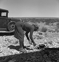 0124128 © Granger - Historical Picture ArchiveMIGRANT WORKER, 1938.   A young African American wife cooking breakfast roadside on the outskirts of El Paso, Texas. Photograph by Dorothea Lange, June 1938.