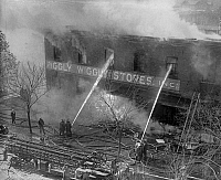 0126795 © Granger - Historical Picture ArchivePIGGLY WIGGLY FIRE, 1923.   Firefighters battling a fire at a Piggly-Wiggly self-service supermarket, 1923.