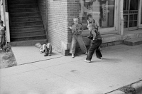0409510 © Granger - Historical Picture ArchiveGUN FIGHT, 1939.  Boys having a toy gun fight in Boscobel, Wisconsin. Photograph by John Vachon, 1939.