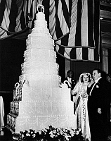 0132089 © Granger - Historical Picture ArchiveWEDDING CAKE, 1947.   James Fosco likes the frosting on his 15 foot wedding cake. The 7 lower tiers are hollow, frosted base. Photograph, Chicago, 1947.