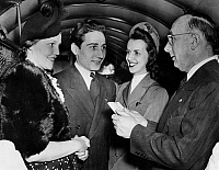 0216854 © Granger - Historical Picture ArchiveAIRPLANE WEDDING, 1940.   Couple Ruth Bibbons and John J. Vahanian (left) defying superstition by getting married on Friday the 13th of December, 1940, aboard a TWA plane over Philadelphia Municipal Airport, Philadelphia, Pennsylvania. Magistrate Jacob Dogole presided over the ceremony, and stewardess Evelyn Scholhamer served as maid of honor.