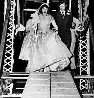 0216856 © Granger - Historical Picture ArchiveFERRIS WHEEL WEDDING, 1956.   Betty Watts, 18, and ferris wheel foreman Harry Coulman, 25, leaving the ferris wheel where they had just gotten married in Crawfordsville, Indiana, 26 July 1956, three years after they had met at a carnival in Watts' hometown of Watseka, Illinois.