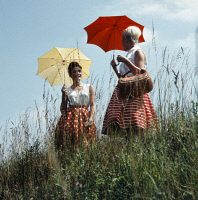 0621502 © Granger - Historical Picture ArchiveGERMANY: WOMEN, 1955.  Two women with parasols walking. Photograph by Oscar Poss, July 1955. Full Credit: ullstein bild - Oskar Poss / Granger, NYC. All Rights Reserved.