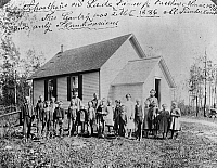 0130182 © Granger - Historical Picture ArchiveMINNESOTA: SCHOOL, c1895.   Children, probably of German immigrant settlers, in front of a one room schoolhouse near Fosston, Minnesota, c1895.