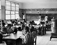 0259275 © Granger - Historical Picture ArchiveALABAMA: SCHOOLHOUSE, 1939.   A first grade classroom in Gee's Bend, Alabama, showing the extreme ages of the students. Photograph by Marion Post Wolcott, 1939.
