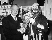 0091793 © Granger - Historical Picture ArchiveCIRCUS: RINGLING BROS.   John Ringling North, owner of the Ringling Bros. and Barnum & Bailey Circus, congratulating Rick Shapiro, the winner of a clown contest, in 1966.