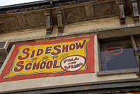 0121733 © Granger - Historical Picture ArchiveCONEY ISLAND: SIDESHOW.   Banner for Sideshow School at the Circus Side Show at 12th Street and Surf Avenue. Photograph, 2009. Full credit: Maggie Downing / Granger, NYC -- All rig New York.