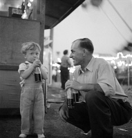 0623899 © Granger - Historical Picture ArchiveOREGON: CIRCUS, 1942.   A boy and a man drinking sodas at the circus in Klamath Falls, Oregon. Photograph by Russell Lee, July 1942.