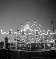 0623901 © Granger - Historical Picture ArchiveOREGON: CIRCUS, 1942.   Carnival rides at the circus at Klamath Falls, Oregon. Photograph by Russell Lee, July 1942.