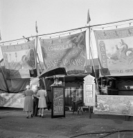 0623931 © Granger - Historical Picture ArchiveCIRCUS: SIDESHOW, 1942.   Sideshow entrance at a circus in Klamath Falls, Oregon. Photograph by Russell Lee, July 1942.