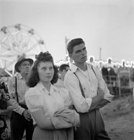0623933 © Granger - Historical Picture ArchiveCIRCUS: SPECTATOR, 1942.   Spectators at a circus sideshow in Klamath Falls, Oregon. Photograph by Russell Lee, July 1942.