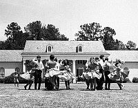 0259335 © Granger - Historical Picture ArchiveFLORIDA: DANCERS.   A group of dancers outside the Stephen Foster Memorial Museum in White Springs, Florida. Photograph, late 20th century.