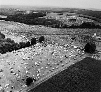 0129576 © Granger - Historical Picture ArchiveWOODSTOCK FESTIVAL, 1969.   Aerial view of the Woodstock Music Festival at Bethel, Sullivan County, north of New York City, 16 August 1969. The bandstand can be seen at the upper center of the image. Photograph by Marty Lederhandler.