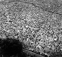 0129578 © Granger - Historical Picture ArchiveWOODSTOCK FESTIVAL, 1969.   Aerial view of the crowd at the Woodstock Music Festival, 16 August 1969, at Bethel, Sullivan County, north of New York City. Photograph by Marty Lederhandler.