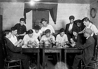 0130089 © Granger - Historical Picture ArchiveCARD GAME, 1916.   A group of young Portuguese-American mill workers from Fall River, Massachusetts, playing cards and gambling after work. Photograph by Lewis Hine, 1916.