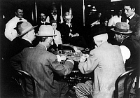 0130094 © Granger - Historical Picture ArchiveRENO: GAMBLING, 1910.   Men gambling on a game of faro at a casino in Reno, Nevada, 1910.