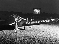 0170360 © Granger - Historical Picture ArchiveDRIVE-IN THEATER, 1951.   A small plane at a drive-in, fly-in theater at Farmingdale, New Jersey, where planes land at a nearby airport and taxi down special runways to the theater. Photograph, 1951.