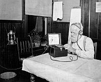 0003840 © Granger - Historical Picture ArchiveMIDWESTERN FARMER, 1921.   A midwestern American farmer tuning in the weather forecast on his crystal set radio receiver. Photograph, 1921.