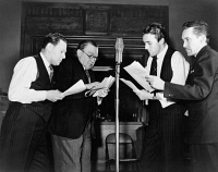 0622957 © Granger - Historical Picture ArchiveWWII: RADIO PROPAGANDA.   Rehearsal for the radio show 'You Can't Do Business With Hitler,' written and produced by the Office of War Information. Photograph by Howard Liberman, c1942.