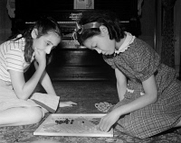 0323827 © Granger - Historical Picture ArchiveCHINESE CHECKERS, 1942.   A Chinese-American girl playing Chinese checkers with her Jewish friend at home in Flatbush, Brooklyn, New York. Photograph by Marjory Collins, 1942.