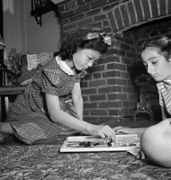 0323828 © Granger - Historical Picture ArchiveCHINESE CHECKERS, 1942.   A Chinese-American girl playing Chinese checkers with her Jewish friend at home in Flatbush, Brooklyn, New York. Photograph by Marjory Collins, 1942.