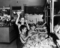 0622296 © Granger - Historical Picture ArchiveMARYLAND: BOYS PLAYING.   Boys playing with toys in a store, Greenbelt, Maryland. Photograph by Gretchen Van Tassel, 1946.