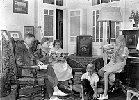 0108749 © Granger - Historical Picture ArchiveFAMILY, 1930s.   A family in Jerusalem seated around a radio, reading. Photographed between 1937 and 1941.
