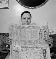 0323826 © Granger - Historical Picture ArchiveREADING, 1942.   A Chinese-American man reading 'The Chinese Nationalist Daily' newspaper at his home in Flatbush, Brooklyn, New York. Photograph by Marjory Collins, 1942.