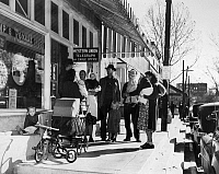 0129617 © Granger - Historical Picture ArchiveSMALL TOWN U.S.A., 1949.   Families with babies meeting, Saturday afternoon, on Main Street, Buchanan,(probably Michigan), June 1949.