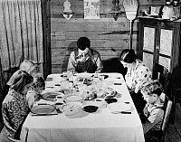 0032780 © Granger - Historical Picture ArchiveFAMILY SUPPER, 1941.   A family saying grace before afternoon supper at home in Carroll County, Gerogia. Photograph, 1941, by Jack Delano.