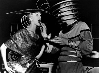 0322730 © Granger - Historical Picture ArchiveFUTURE FASHION, 1951.   A couple dressed in futuristic clothing, wearing radar and television antennas as headgear. Photograph, 1951.