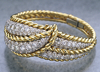 0106341 © Granger - Historical Picture ArchiveVERDURA: GOLD BRACELET.   Gold bracelet set with diamonds. Made by Fulco di Verdura (1898-1978), late 1940s.