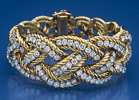 0106342 © Granger - Historical Picture ArchiveVERDURA: GOLD BRACELET.   Gold bracelet set with diamonds. Made by Fulco di Verdura (1898-1978), early 1940s.