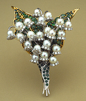 0106345 © Granger - Historical Picture ArchiveVERDURA: PIN, 1970.   Lily-of-the-valley pin made of emeralds, diamonds, and pearls. Made by Fulco di Verdura, 1970.