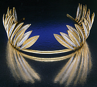 0106359 © Granger - Historical Picture ArchiveVERDURA: TIARA.   Gold and diamond tiara in the form of an Indian headdress. Made by Fulco di Verdura (1898-1978).