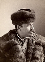 0093558 © Granger - Historical Picture ArchiveMEN'S FASHION, 1890s.   Unidentified man sporting a fur coat and fur hat, 1890s.
