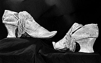 0125944 © Granger - Historical Picture ArchiveSATIN SHOES, c1750.   A pair of fringed white satin shoes. American, c1750.