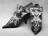 0125945 © Granger - Historical Picture ArchiveEMBROIDERED SHOES, 1690s.   A pair of white kid leather shoes with embroidered silk floral design. French, 1690s.