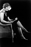 0093333 © Granger - Historical Picture ArchivePATTERNED STOCKINGS, 1920s.   Model wearing patterned stockings coordinated with her dress, 1920s.