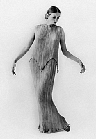 0016136 © Granger - Historical Picture ArchiveWOMEN'S FASHION, c1912.   Pleated apricot silk Mariano Fortuny y Madrazo dress. Photograph, c1912.