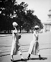 0017275 © Granger - Historical Picture ArchiveWOMEN'S FASHION, c1920.   Two young campaigners for equal rights tipping their hats in Washington, D.C.