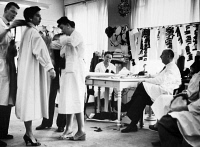 0108884 © Granger - Historical Picture ArchiveCHRISTIAN DIOR (1905-1957).   French fashion designer. Dior in a studio, supervising the draping of a model, c1950.