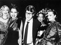 0109083 © Granger - Historical Picture ArchiveYVES SAINT LAURENT (1936-2008).   French fashion designer. Saint Laurent (center) with models wearing his clothes at the Fall-Winter Haute Couture fashion show at Paris. Photographed 1979.