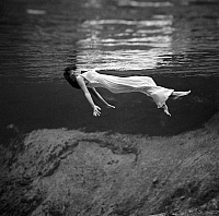 0118624 © Granger - Historical Picture ArchiveWOMAN FLOATING, 1947.   A woman in a fancy dress floating underwater at Weeki Wachee Springs, Florida. Photographed by Toni Frissell, 1947.