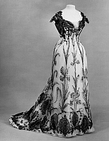 0125941 © Granger - Historical Picture ArchiveWOMEN'S FASHION, 1899.   Sequined white chiffon evening dress with printed design in black, made by Doeuillet of Paris, 1899.
