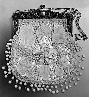 0125946 © Granger - Historical Picture ArchiveSATIN AND LACE PURSE.   White satin purse with Irish crochet lace. Probably French, late 19th century.