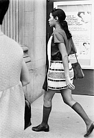 0126799 © Granger - Historical Picture ArchiveWOMEN'S FASHION, 1970s.   A young woman wearing a striped miniskirt and calf-length stockings, New York City, early 1970s.