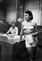 0167427 © Granger - Historical Picture ArchiveFASHION: LINGERIE, 1949.   An undergarment model and a secretary at a lingerie company in Chicago, Illinois. Photograph by Stanley Kubrick, 1949.